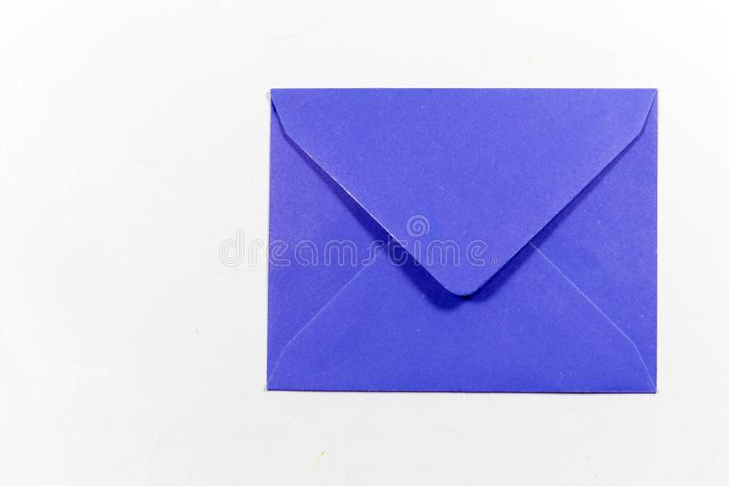 Color letter envelopes and colored hearts. A flat paper container with a flap, used to enclose a letter or document stock photo