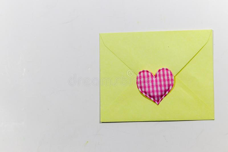 Color letter envelopes and colored hearts. A flat paper container with a flap, used to enclose a letter or document stock images