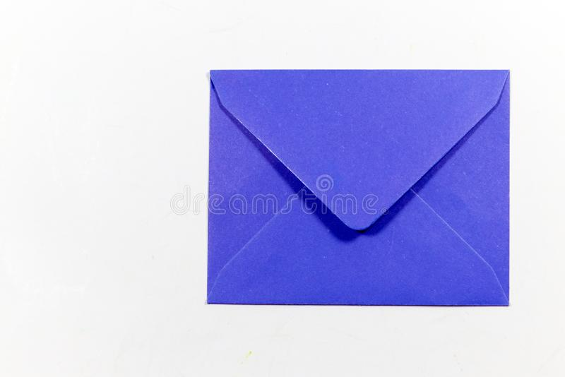 Color letter envelopes and colored hearts. A flat paper container with a flap, used to enclose a letter or document stock image