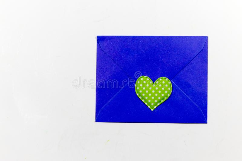 Color letter envelopes and colored hearts. A flat paper container with a flap, used to enclose a letter or document stock photos