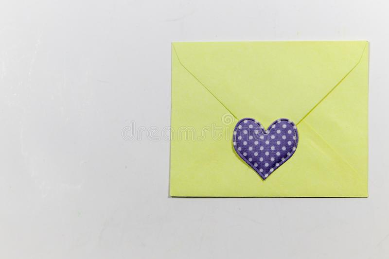 Color letter envelopes and colored hearts. A flat paper container with a flap, used to enclose a letter or document royalty free stock images