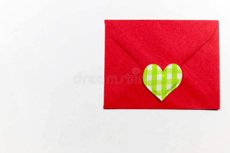 Color letter envelopes and colored hearts. A flat paper container with a flap, used to enclose a letter or document stock photography
