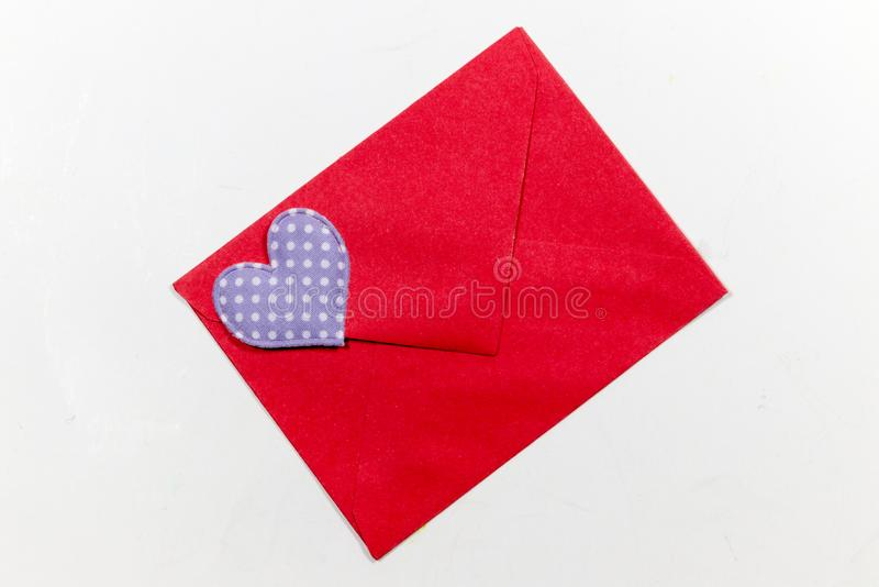 Color letter envelopes and colored hearts. A flat paper container with a flap, used to enclose a letter or document royalty free stock photo
