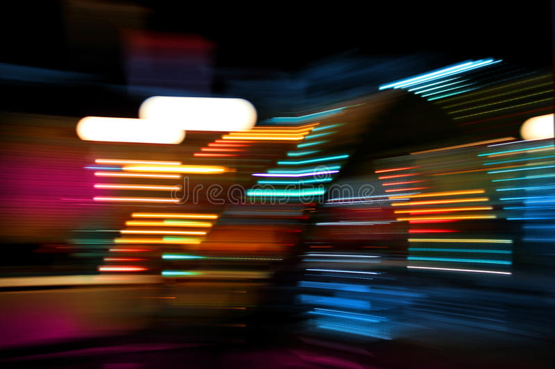 Color lights moving. Colorful lights of urban surrounding blurred by motion