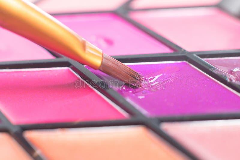 Color lipstick palette, close-up brush. decorative cosmetics. Beauty Blog stock image