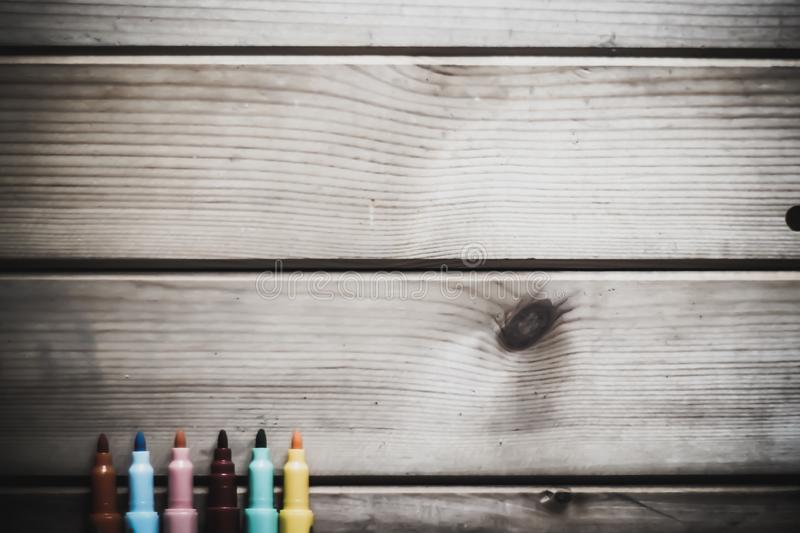 Color magic pens with wooden rustic background with copy space. For creative idea royalty free stock photos