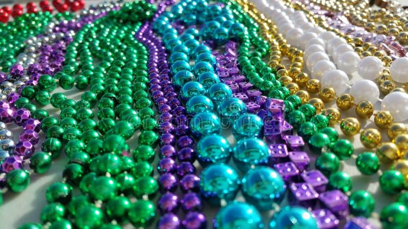 Color of Mardi Gras Metallic Beads royalty free stock photos