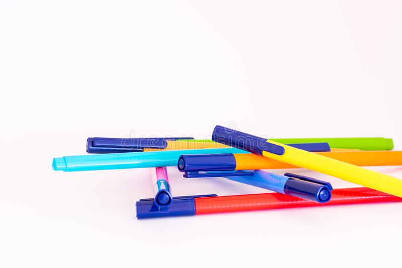 Color markers disposed randomly, white background. Various color markers disposed randomly, white background royalty free stock photography