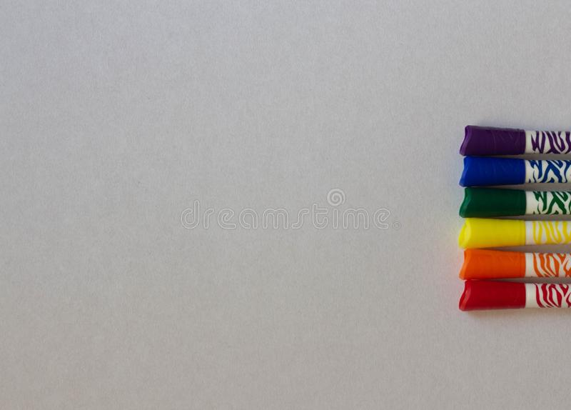 Colored LGBT markers on a white background close-up stock illustration
