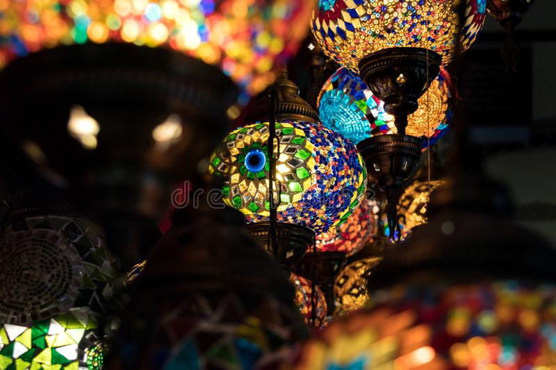 Colorfull Moroccan style lanterns lamp hanging down from ceiling stock photography