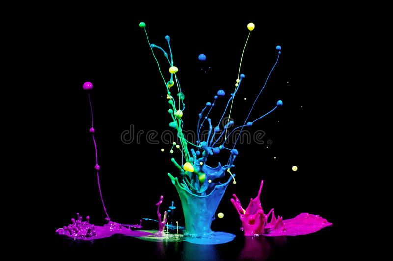 The Color of Music. This is a colorful paint splash on a audio speaker isolated on a black background. This shows the color of music royalty free stock photo