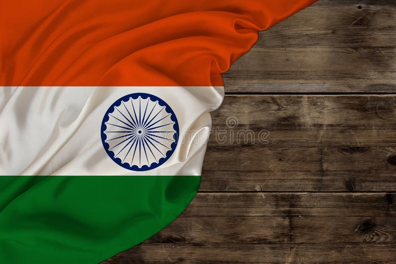 Color national flag of modern state of india, beautiful silk, old wood background, concept of tourism, economy, politics, stock image