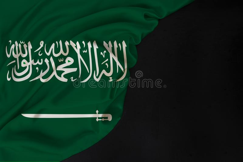 Color national flag of modern state of Saudi Arabia, beautiful silk, black blank form, concept of tourism, economy, politics,. Emigration, independence day royalty free stock photography