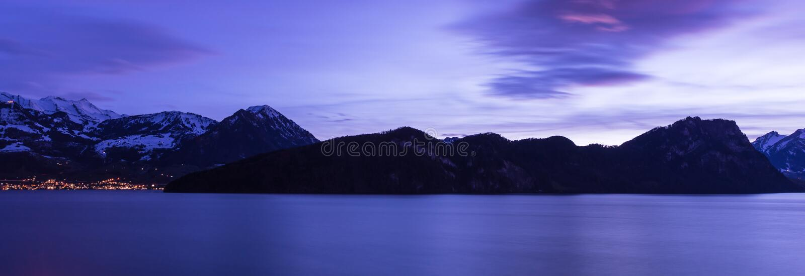 The color of the night is Royal Blue. Lucerne Lake. Vitznau. Night panorama. Lake Lucerne. Swiss Alps. Long exposure abstract architecture background beautiful royalty free stock photo