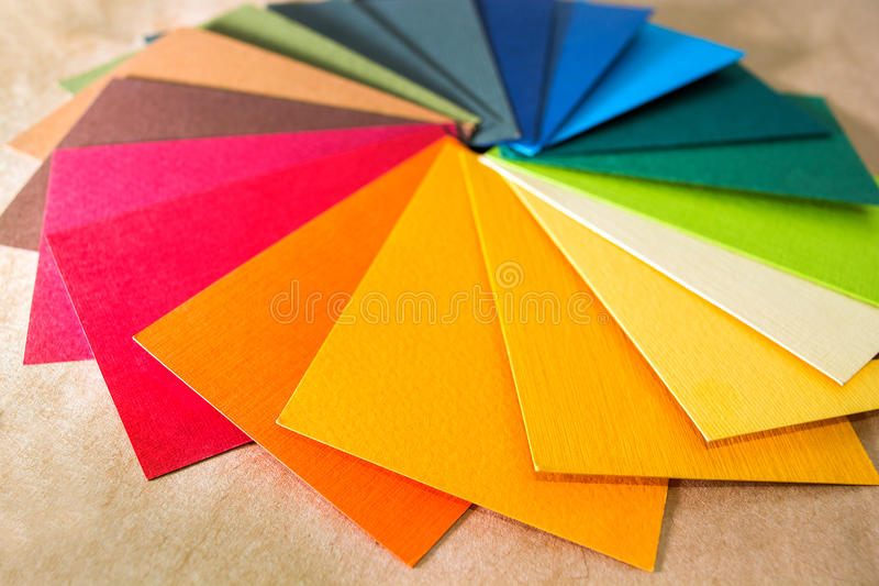 Color palette guide. Colored textured paper samples swatch catalog. Bright and juicy rainbow colors. Beautiful abstract background. Back to school. Office stock photo