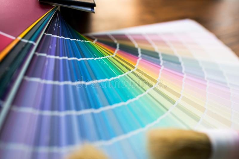Color palette, guide of paint. On the table royalty free stock photography