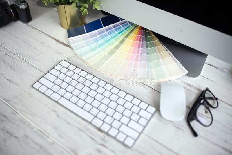 Color palette guide on white background,Focus exclusively on ,table working on laptop. Computer royalty free stock photos