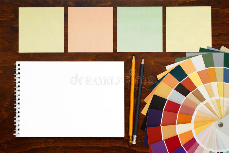 Color palette guide on the wooden background and notepad. mockup, template. Workplace designer.Color palette guide on the wooden background and notepad. mockup royalty free stock photography