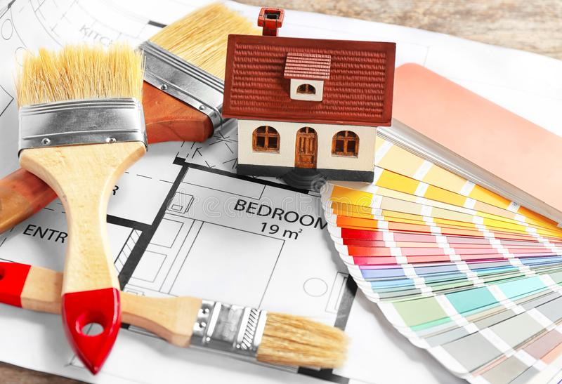 Color palette samples, model of house and brushes. On project drawing royalty free stock photos