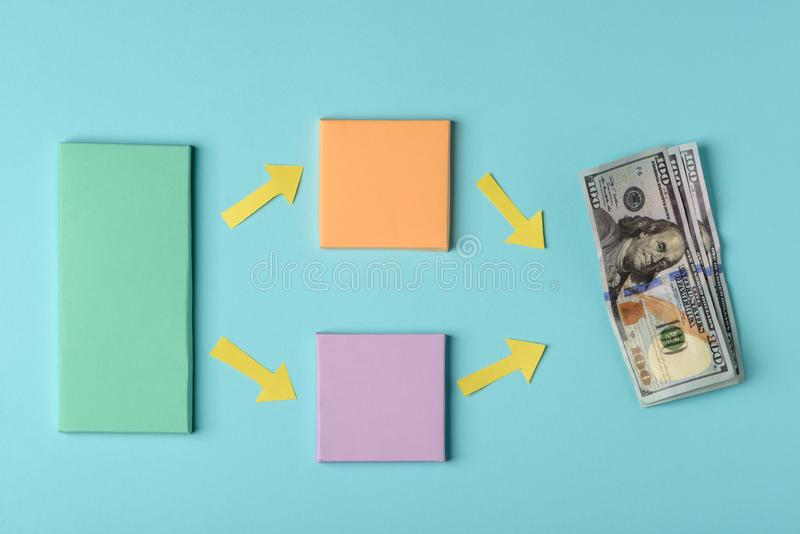 Color paper blocks and banknotes. On blue background. Different ways to earn money, creative concept for advertisment stock image