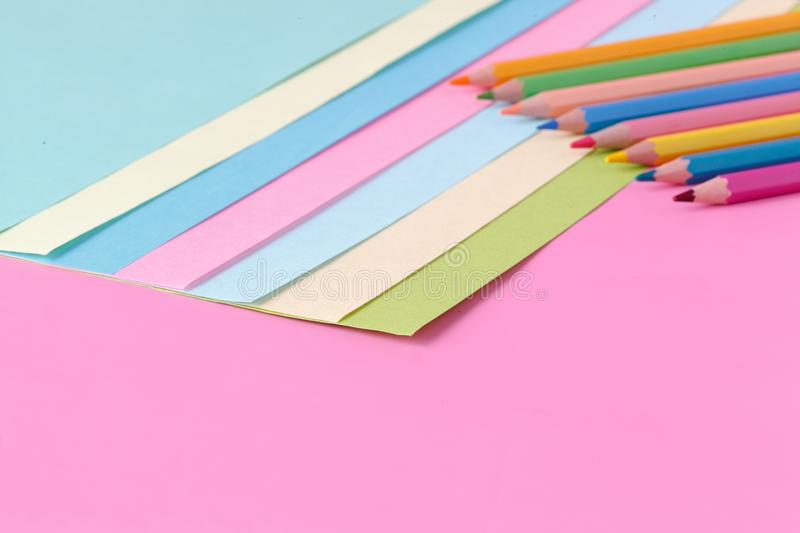 Color paper and pen on pink background, creative concept stock photo
