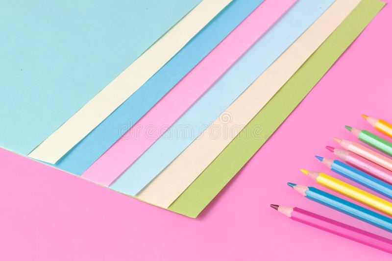 Color paper and pen on pink background, creative concept royalty free stock images
