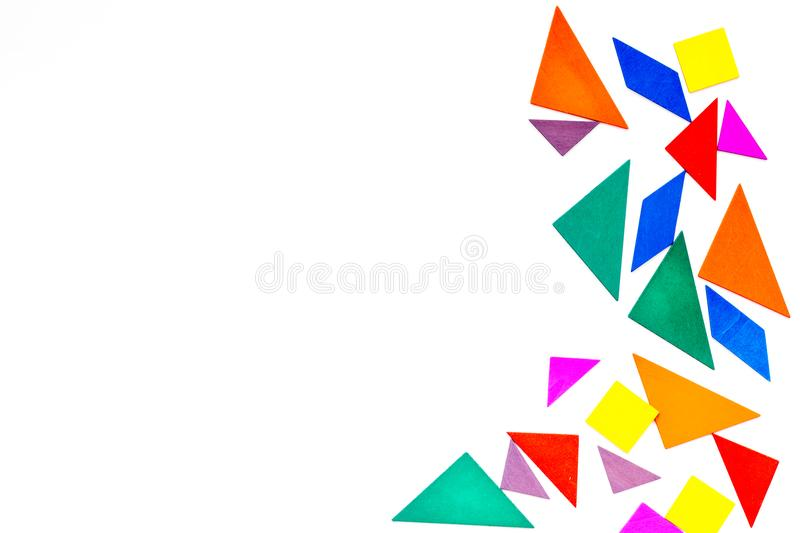 Color paper pieces for business puzzle white table background top view space for text stock images