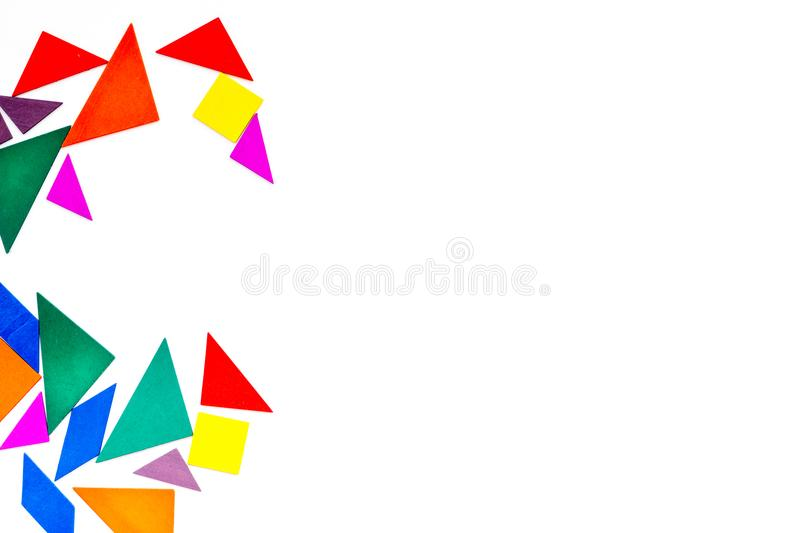 Color paper pieces for business puzzle white table background top view space for text royalty free stock photo