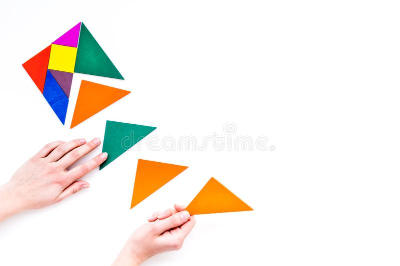 Color paper pieces for business puzzle white table background top view space for text royalty free stock images