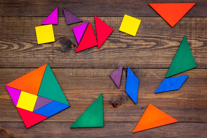 Color paper pieces for business puzzle wooden table background top view pattern stock images