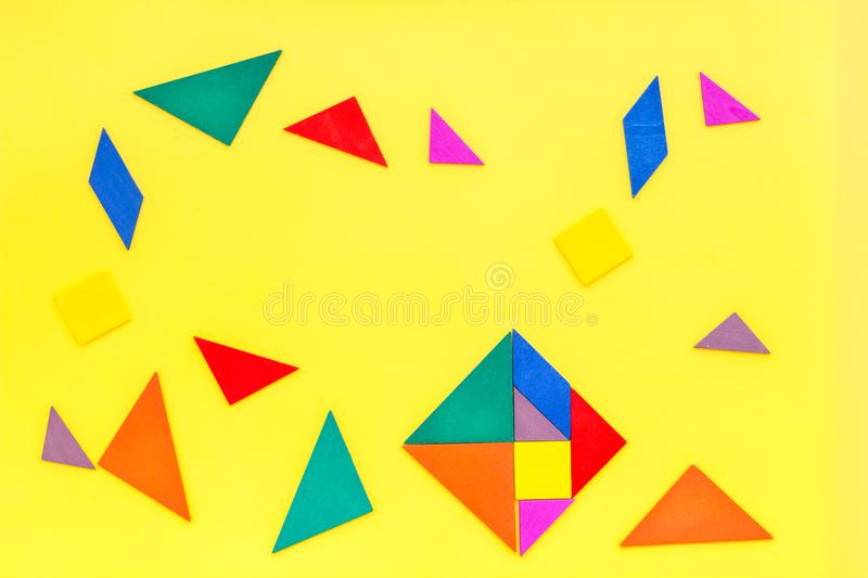 Color paper pieces for business puzzle yellow table background top view pattern royalty free stock image