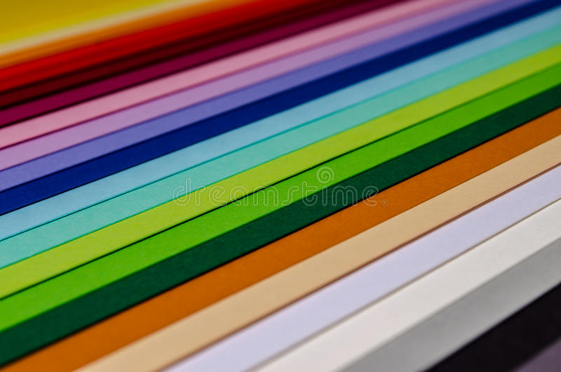 Color paper. Paper in various colors. Multicolored sheets paper. Photo close up stock photos