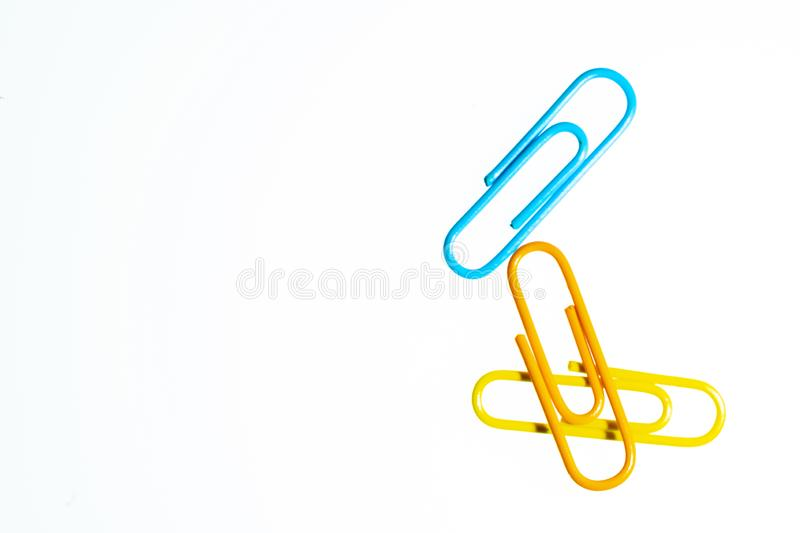 Color Paperclips white background isolated stock photo