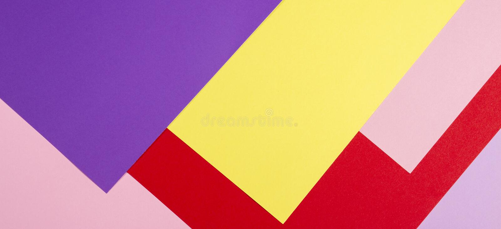 Color papers geometry flat composition background with violet, purple, pink, red, yellow tones. Color papers geometry flat composition background with violet stock images
