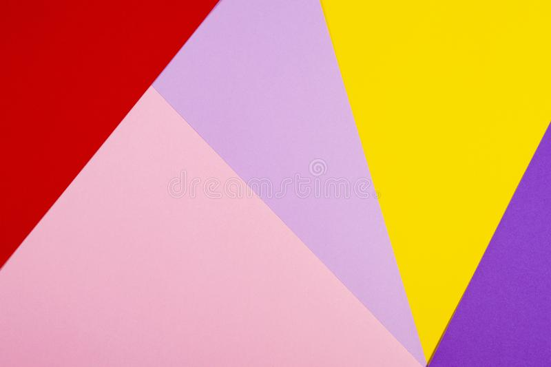 Color papers geometry flat composition background with violet, purple, pink, red, yellow tones. Color papers geometry flat composition background with violet royalty free stock photo