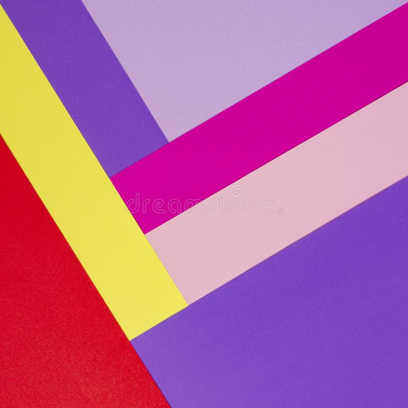 Color papers geometry flat composition background with violet, purple, pink, rose, red, yellow tones. Color papers geometry flat composition background with royalty free stock image
