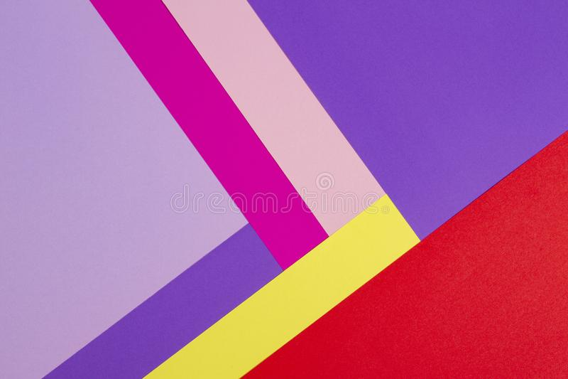 Color papers geometry flat composition background with violet, purple, pink, rose, red, yellow tones. Color papers geometry flat composition background with royalty free stock photo