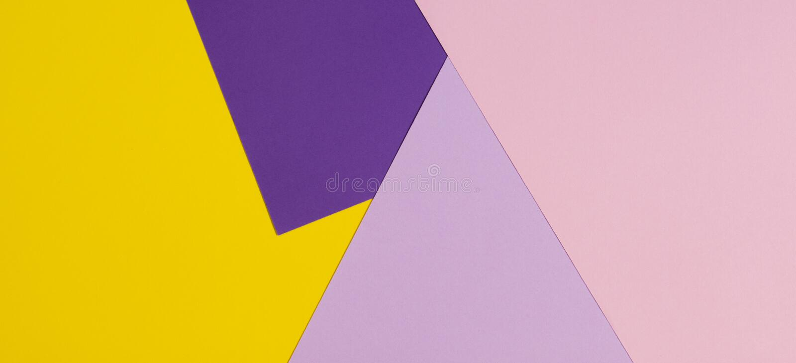 Color papers geometry flat composition background with violet, purple, pink, yellow tones. stock photo