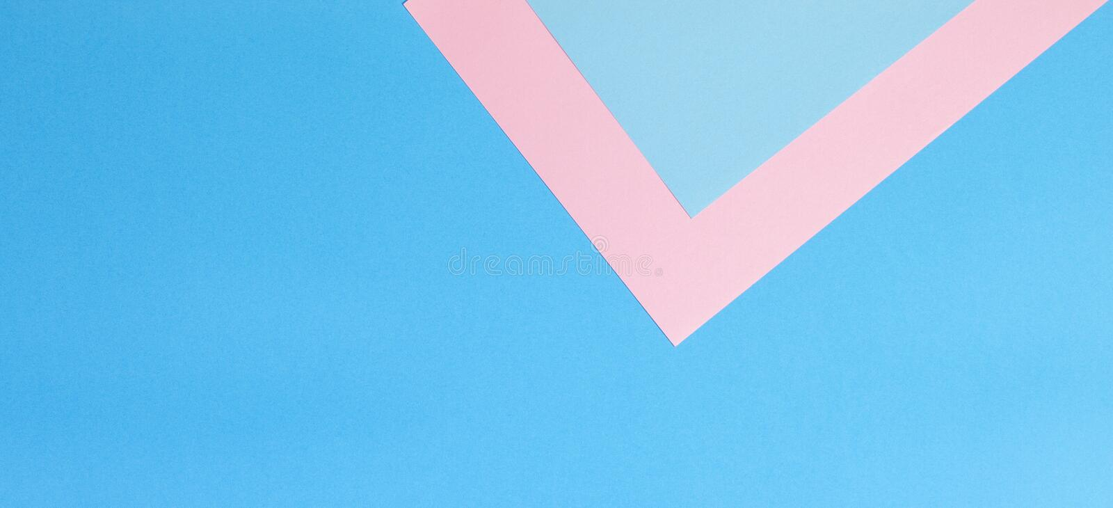 Color papers geometry flat composition background with pink and blue tones. Color papers geometry flat composition banner background with pink and blue tones royalty free stock photos