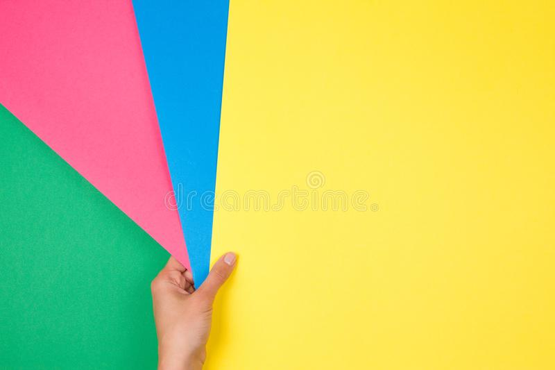 Color Papers Geometry Flat Composition With Female Hand Holding ...