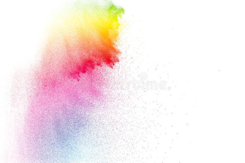 Color particles splatter on white background. Colorful dust splash on white background stock photo