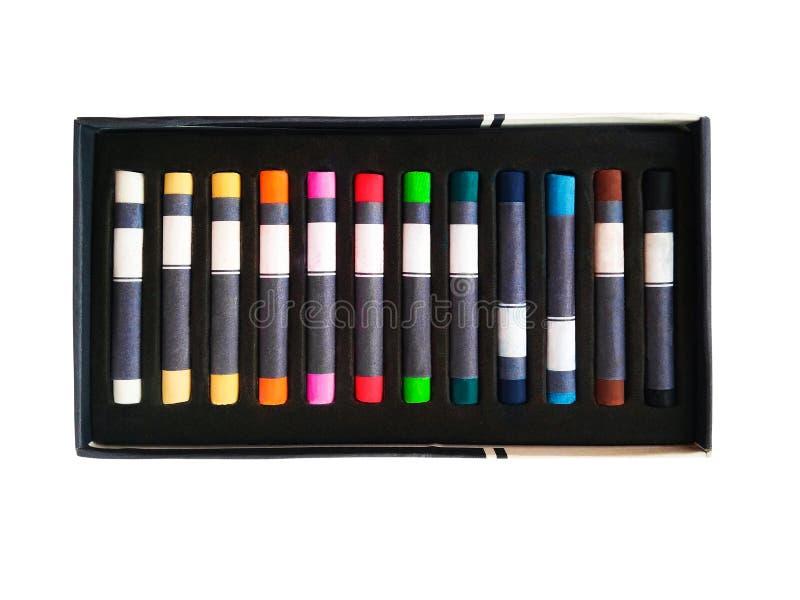 Color pastel crayons or pencils in box stock photos