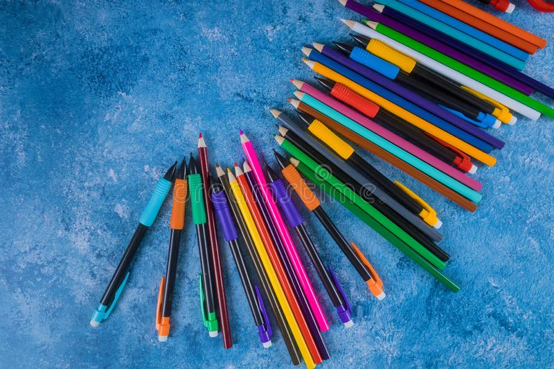 Color pencil on blue background. Back to school stock photos