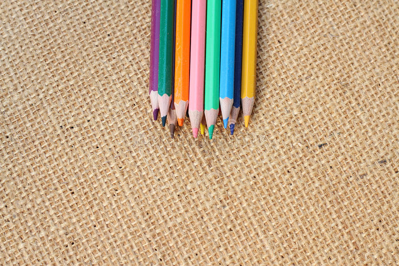 Color Pencil on hemp background in selective focus royalty free stock photos