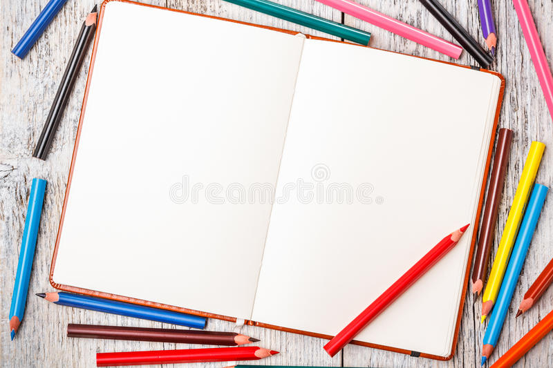 Color pencil and notepad stock photo