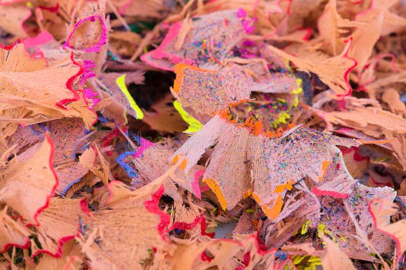 Color pencil shaves background. Colorful pencil shavings in close-up. Pencils shavings wallpaper.  stock photography
