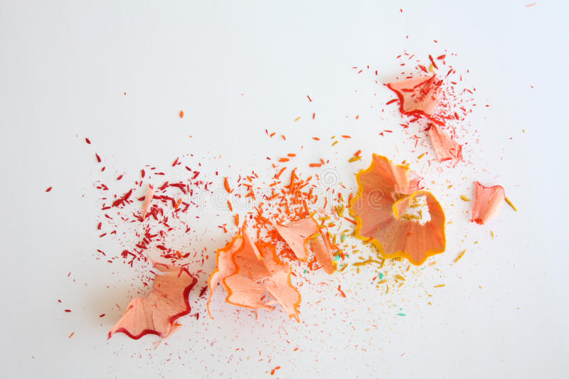 Color pencil shaves on white. Background royalty free stock photography