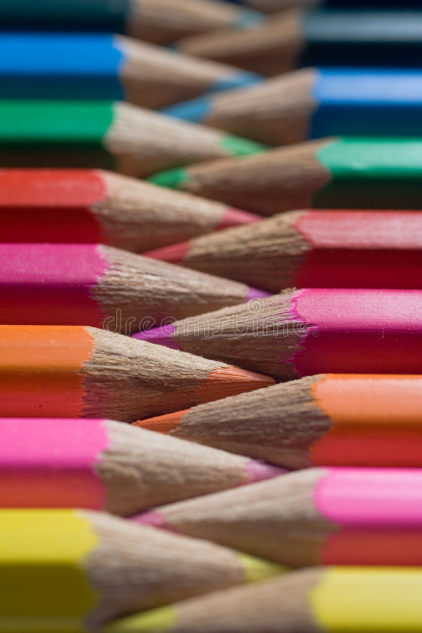 Color Pencils. Row of color pencils, side by side, alternating in opposite directions. Closeup on point area royalty free stock photo