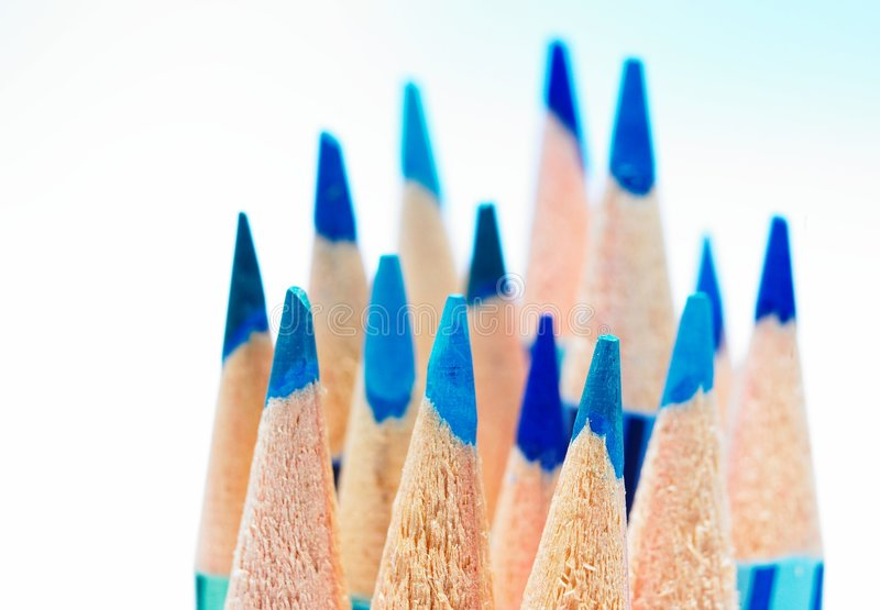 Color pencils. Lots of sharpened blue color pencils in blue background royalty free stock photos