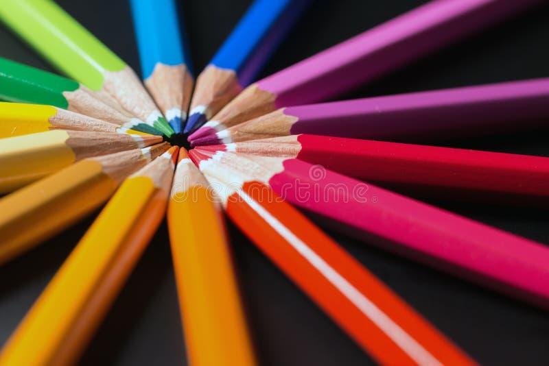 Color pencils in arrange in color wheel. Assortment of colored pencils. Colored pencils royalty free stock photography